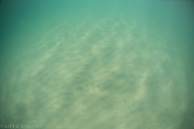 Clear sandy water.